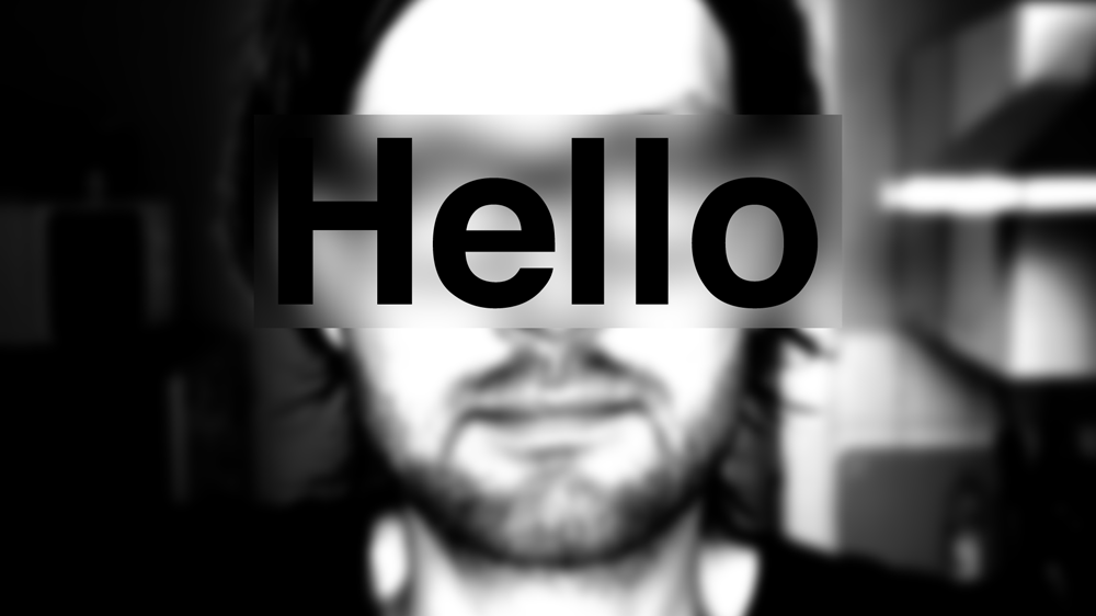 A blured black and white portrait image with the word hello world on top